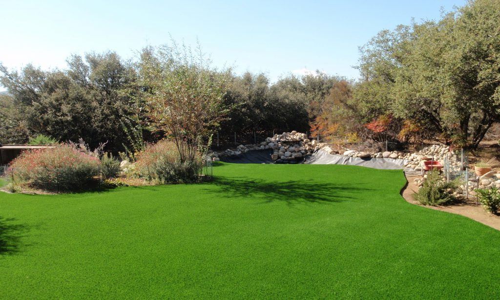 Large backyard created with artificial grass