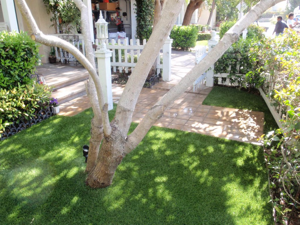 Small front yard made with artificial grass