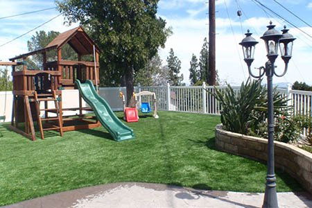 Children's playground using artificial grass